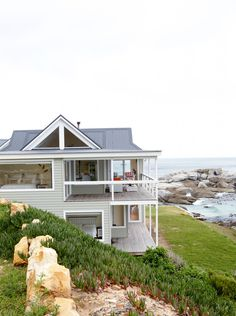 Taking a break With its pitched roof, wraparound balcony, large picture windows and traditional styling, this double-storey, four-bedroom timber beach house is ideal for life at the coast. White Beach Houses, Building Aesthetic, Double Storey House, House With Balcony, Beach Mansion, Beach House Plans, Facade House, House Exteriors, Modern Coastal