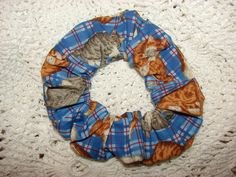 Check out this item in my Etsy shop https://www.etsy.com/listing/251891811/cats-tabbies-blue-plaid-fabric-hair