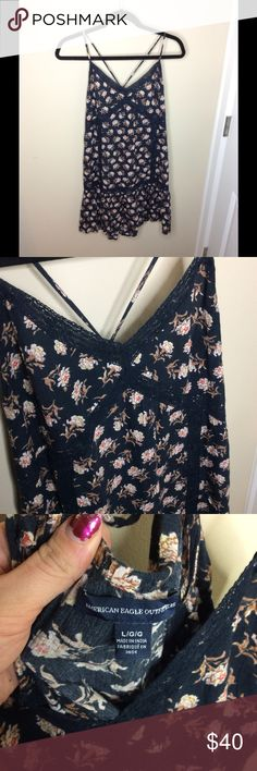 Floral American Eagle mini dress Worn on one vacation!! Super cute, crossed back straps, lace lined, short. Size large American Eagle Outfitters Dresses Mini