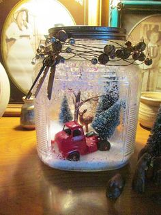 Christmas Globe - Took a vintage cookie jar sprayed adhesive inside poured some snow inside ,shook, and used Epsom salt for the snow drifts, decorated inside an…