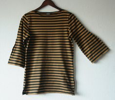 MARIMEKKO womens top Brown black striped shirt Nautical top Marine Sailor top Cotton shirt Boat neck Bell sleeves Made in Finland Beautiful Marimekko womens top in brown and black horizontal stripes print. 3/4 bell sleeves, boat neck and slits on the sides. Made in Finland Brand: MARIMEKKO Material: 100% cotton  Color: brown, black  Marked size: S (please check the measurements)  LYING FLAT Measurements: (you dont need to double anything) length 69 cm/27 bust 92 cm/36 shoulder...