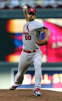 National League starting pitcher Adam Wainwright, of the St. Louis Cardinals, throws during the first inning of the MLB All-Star baseball game, Tuesday, July 15, 2014, in Minneapolis. (AP Photo/Jim Mone)