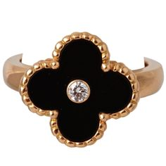 This is a great ring from Van Cleef & Arpelss vintage Alhambra collection. Its simple, but theres a lot of design in this little ring. The beaded gold around the flower in particular is a really nice touch. Van Cleef And Arpels Jewelry, Jewelry Accessories, Jewelry Design, Vintage Jewelry, Unique Jewelry, Onyx Ring, Diamond Are A Girls Best Friend, Black Rings, Bling