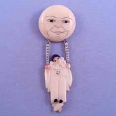 French Carved Plastic 'Pierrot Swinging from the Moon' Articulated Brooch