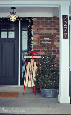 Star light on porch, blk door, beefy posts, numbers. The christmas decor looks like our house now....simple. :)