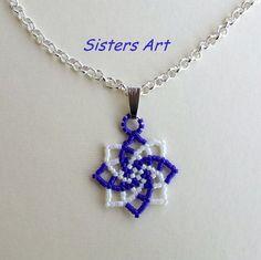 """Collana """"Stella azzurra""""  realizzata con la tecnica peyote utilizzando perline delica, by Sisters Art, in vendita su http://www.misshobby.com/it/negozi/sisters-art"""