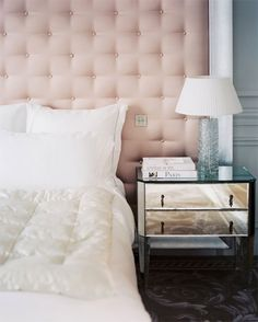 A two-drawer table clad in mirrored panels is a glamorous showstopper in front of a massive soft pink button-tufted house design home design interior design 2012 interior room design Bedroom Photos, Home Bedroom, Bedroom Decor, Gray Bedroom, Shabby Bedroom, Copper Bedroom, Parisian Bedroom, Blush Bedroom, Clean Bedroom