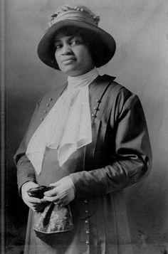 """From the Ohio collection within """"American Memory"""" -- Unidentified African-American woman standing, wearing a dress and hat, and holding a purse."""