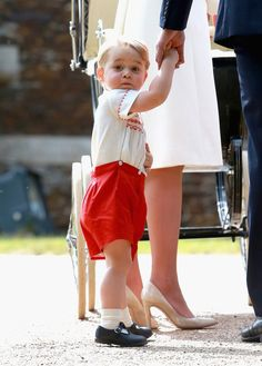 He knew where the camera was at all times. | Pictures Of Prince George Totally Stealing The Show At His Sister's Christening