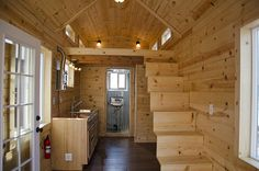 A 280 square feet tiny home on wheels with wet bath and composting toilet in Nampa, Idaho.  There is much too much of the kitchen taken away here because the entire under-stair is closet space and a laundry.