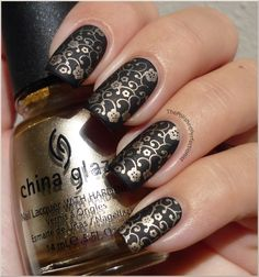 The Polished Perfectionist: Black & Gold  There are many ways to spice up black nails; this time I decided to add some stamping. I used China Glaze - 2030 and a floral design from Konad plate M73. I wondered how it would look matte, so I also applied one coat of Essence's matte top coat. I like this mani so much! The matte finish makes it look so, uhm.. interesting?
