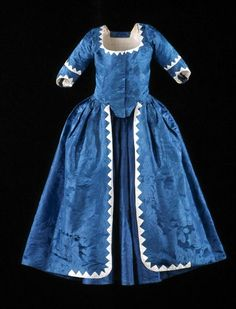 blue damask, sawtooth silk trim Gown: ca. 1780-1795, ca. 1740-1750 (textile), European, French or English, silk damask, silk tabby appliqué, bodice and sleeves lined with linen, skirt lined with silk sarcenet. [Search for Acc. No. 1960-713,A]