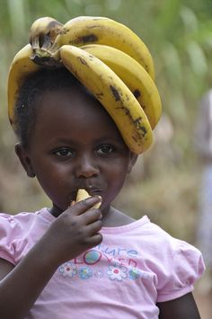 A girl displaced by war sits in the Makpandu refugee camp in Southern Sudan, .