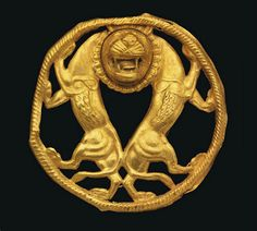 A ZIWIYE GOLD ROUNDEL   CIRCA 7TH CENTURY B.C.   With two addorsed rampant lions, their hindquarters touching, necks joined by a single head with jaws gaping, teeth bared and tongue protuding, mane and whiskers delineated, their feet resting on incised circular border  2 1/8 in. (5.5 cm.) diam.