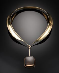 Necklace, Gilt sterling silver collar with a removable pendant with a rutile quartz, 1950s // designed by Vivianna Torun Bülow-Hübe for Georg Jensen.