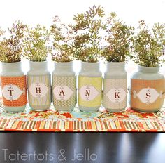 Make a thankful jar centerpiece with old jars and paint. Love this idea!