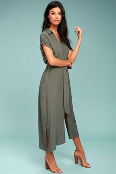 Lulus Exclusive! No matter where you are headed you will want to bring the Destination Chic Olive Green Midi Dress along! This easy to wear dress shaped from woven viscose features short sleeves, and a shift bodice with collared neckline. Button placket and sash belt top a midi skirt with hidden side-seam pockets and side slits.