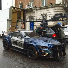 Police Blue Ford Mustang 2019 at the filming of the Transformers movie with the black Porsche Cayenne on the background Mustang Cars, Ford Mustang Gt, Ford Gt, Us Cars, Sport Cars, Shelby Gt 500, Carros Lamborghini, Emergency Vehicles, Police Cars