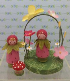 Little Miss Strawberry is a delightful 2 peg doll with a leafy cape tossed around her shoulders. Handcrafted from wood and painted with love, by artist Jone Hallmark, Miss Strawberry is quite the Garden Girl. Tiny toadstools and floral arches are not included, but ARE sold in the
