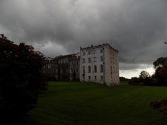 Picton castle in sudden dark cloud.