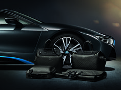 Louis Vuitton has partnered with BMW to create a tailor-made set of luggage crafted in carbon fiber for the BMW i8.