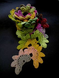 Crochet flowers scarf using Noro yarn. Crochet Flower Scarf, Crochet Scarves, Crochet Shawl, Crochet Flowers, Crochet Lace, Form Crochet, Ravelry, Crochet Amigurumi Free Patterns, Crochet Fashion