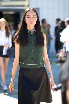a beautiful ensemble mad up of a waxed A-line skirt and Boxy forest green utilitarian/ military vest/blouse NYC Style: Fashion Week from the Street