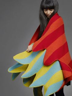"How gorgeous (& cozy) is this ""Seal Pelt Remix"" by Vík Prjónsdóttir & Eley Kishimoto? It is inspired by the colorful feathers of a parrot, and is entirely made from Icelandic sheep's wool."