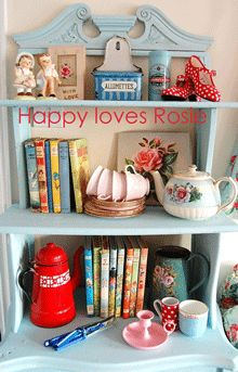 pretty nik naks...; blue shelf with colorful items & vintage books