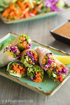 Vegetable spring rolls in rice wrappers, served with a creamy Hoisin-almond butter dipping sauce.