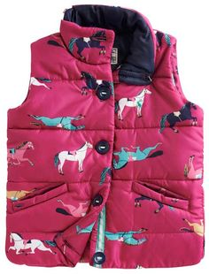 Joules Junior Girl's Marsha Ruby Vest is the perfect addition to your little girl's wardrobe this season! It is made with polyfill insulation to give lightweight warmth and protection. This cute vest sports a classic Joules pony print with a ruby pink background and lined in navy. The look is completed with a mock collar, button up front, and front pockets!  http://www.tackroominc.com/joules-junior-girls-marsha-ruby-vest-p-17359.html