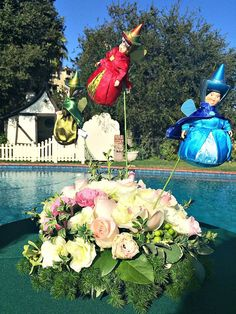 Inside Walt Disney's House (And More Fascinating Disney Secrets) Disney's pool with floating Arrangements! Cool and Magical- shopowerreviews.com