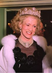 A so far unseen diamond star tiara, with circa five diamond stars alternating with foliate motifs, and worn by the Duchess of St Albans at a Ball in London, February 1998.
