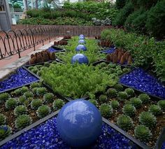 Love the blue! Neat idea: you don't have to plant every inch, just use colored sand or stones to fill in.