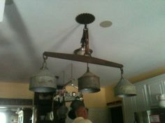 Funnel light made out of old tin oil funnels a Haynes double tree and a block and tackle and a saw blade
