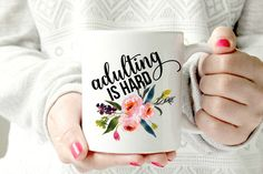 Adulting is hard. Funny mug. Humorous coffee cup. 💗 11 oz white mug 💗 Image printed on both sides 💗 3-5 business day processing 💗 2-3 business day priority shipping This item is professionally printed & heat pressed in my home studio. It is top shelf dishwasher safe & will not wash off (it's not vinyl, YAY!). N O T E: (&Because this is handmade) All of my items are handmade to order my me, I LOVE💗 what I do. They aren't meant to be perfect and are one...