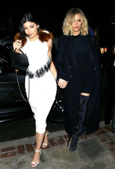 Kylie Jenner turns heads in tight white fur dress with sisters!