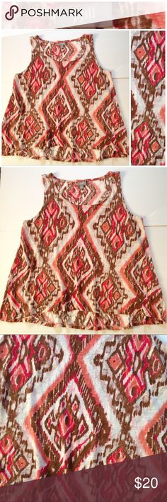 100% Linen Boho Ikat Trapeze Tunic Tank Description: 100% linen, colors are browns and pinks Condition: excellent - no holes or stains See pictures for measurements and material. Comes from a smoke-free home. 👀 Don't like the price, make a reasonable offer. Happy shopping 😍 J. Jill Tops Tank Tops