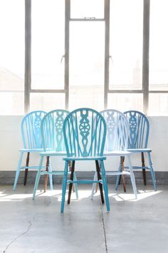 19th century wheel back chairs revamped by 21 year old Yassir, using vibrant shades of blue.  The price of $240 is per chair. There are 6 chairs available.  ...MADE BY OUT OF THE DARK