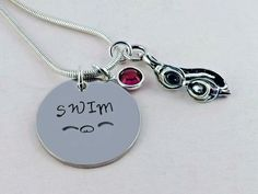 Hand Stamped SWIM Charm with Flyer Symbol Necklace with Sterling Silver Goggles Charm and Crystal Birthstone
