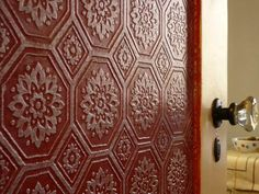 this is embossed wallpaper. we could cover a headboard with it, distress it, and it would have a cool aged metal look