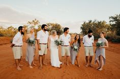 Bridal party on a red dirt road in the Kimberley, Western Australia