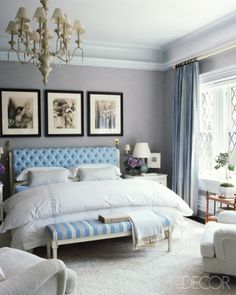 In an upstate New York master bedroom, the custom-made headboard is upholstered in a Bergamo fabric, the bench is antique, and the French chandelier dates from the 1920s; the lamps are by Christopher Spitzmiller, and the curtains are of a Nancy Corzine silk.