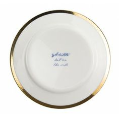 "Poetry Plates - Accessories  Fine bone china plates with gold luster edging and blue text. The large 10 inch plate features a love poem unusually written from the perspective of the plate to you. The medium 8 inch plate reads ""I am nothing but a simple plate, porcelain skin painted gold and blue. I am not a poet, just a dish, but I'll leave that judgement up to you."" The texts are written in a romantic handwritten style of a old love letter complete with dips of ink and imperfections."