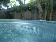 "Another one for the ""worth the effort"" DIY files... Cathy and her husband wanted a chlorine-free pool big enough for the whole family to splash around in during the hot Santa Rosa summer. Hoping for something more attractive than a big vinyl tub, they finally decided on a galvanized steel stock tank. All it took was some clever DIY plumbing, and for about $500 they were living the good life. Learn how they did it after the jump..."