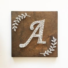 Monogram String Art, Monogram Art, Initial Art, Laurel Branches, Calligraphy Monogram Initial with Laurel Branches Can be created with other fonts - please inquire. Can be created in larger sizes - pl String Art Letters, String Wall Art, Nail String Art, Monogram Signs, Monogram Wreath, Monogram Initials, Letter Monogram, Initial Art, String Art Templates