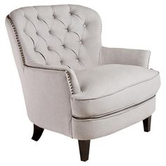 Bring stately appeal to your living room seating group or favorite reading nook with this handsome arm chair, showcasing tufted dove grey upholstery and nail...