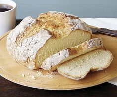 Irish Soda Bread _ Soda bread has been an Irish household staple since baking soda became commercially available in the early 19th century. It uses just four ingredients that most people kept on hand: flour, salt, baking soda, and buttermilk (raisins and caraway seeds are an American addition). A real soda bread is a simple loaf with a beautifully browned, craggy crust and a nice chew, best eaten liberally smeared with salty Irish butter.