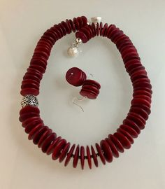 Red coconut shell beads, pewter with SS overlay beads & magnetic clasp.