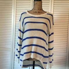 "Slouchy Striped Sweater Casual and slouchy striped (blue/cream) sweater with hi-low effect. In great used condition with a few loose threads and a minor pull on front (pictured). Measures approximately: 18"" bust, 23"" length (front), 27.5"" length (back). Quinn Sweaters Crew & Scoop Necks"